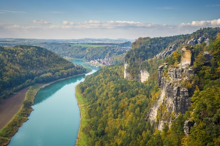 View from viewpoint of Bastei in Saxon Switzerland Germany to the town Wehlen and the river Elbe on a sunny day in autumn