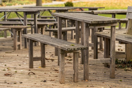 Lonely wooden bench in a German beer garden in autumn Stock Photo - 16239994