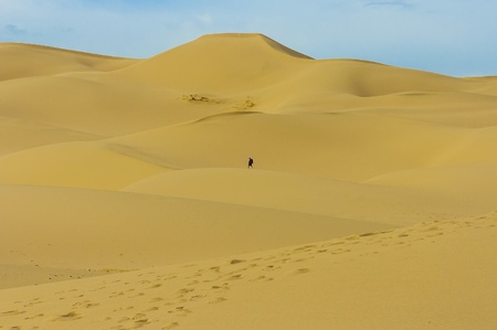 Sand dune in Mongolia desert with one person photo