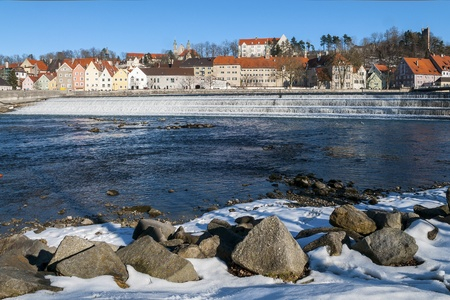 View to a small town in Germany in winter with river and stones in the foreground Stock Photo - 16723386