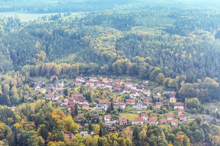 Village bordered with colored trees in saxony switzerland in autumn Stock Photo - 17046058