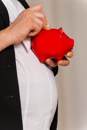 Pregnant Business Woman throws two euro in piggy bank