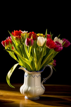 Bouquet of Flowers in Vase on a wooden table and black background Stock Photo - 18033730