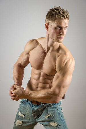 Blond atheltic man with abdominal muscle