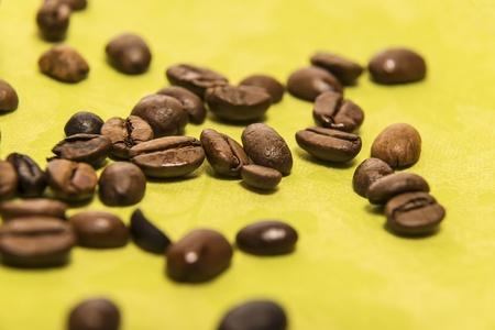 Closeup of coffee beans on a green serviette photo