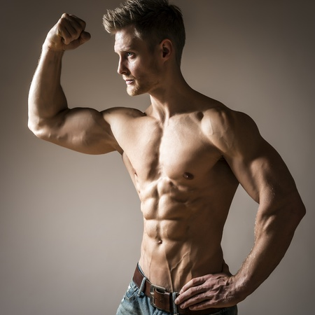 pectoral muscle: Posing young well trained man with perfect abdominam and pectoral muscle