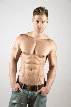 Well trained body of a blond young athetic sport man with nice abs and pecs