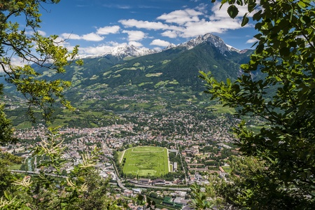 View to Merano in South Tirol on a sunny day with blue sky and white clouds Stock Photo