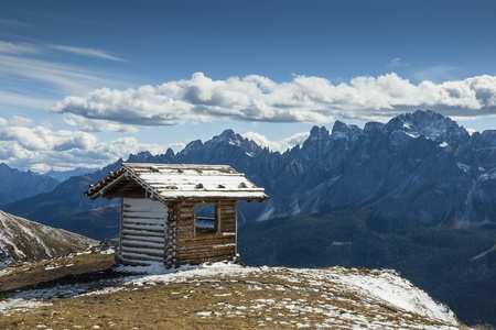 Refuge in the high mountains in South Tyrol on a sunny day with clouds photo