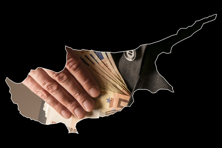 Black outline of the country of Cyprus with a single source in a suit that goes bills into pocket