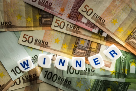 Euro banknotes with white dice with the word Winner photo