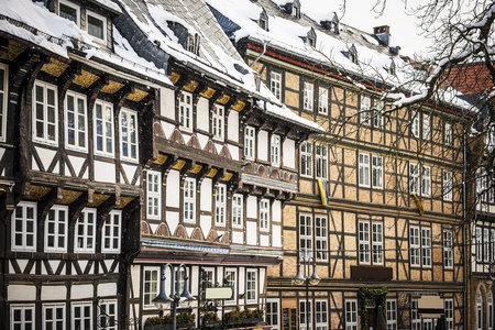 Closeup of half-timbered houses in Goslar, Germany in winther with snowfall photo