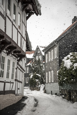 Side street with half-timbered houses in the winter with snow photo
