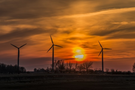 Three windmills in northern Germany in the evening with sunset Stock Photo - 19057425