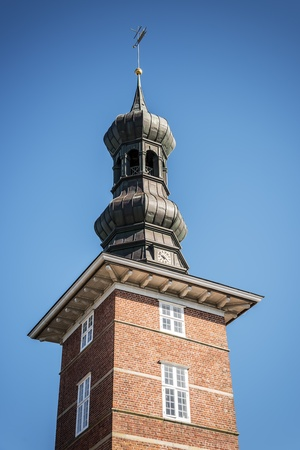 Tower of the castle in Husum with blue sky on a sunny day in spring photo