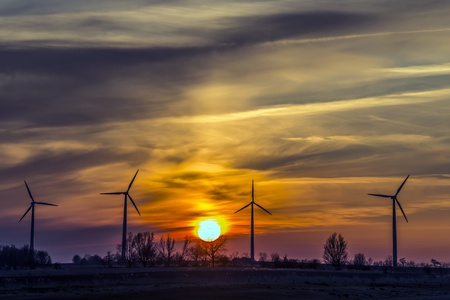 Windmills in northern Germany in the evening with cloudy sky and sunset Stock Photo - 19057430