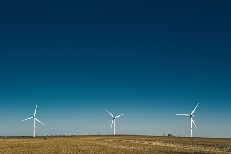 Windmills in northern Germany on a field on a sunny day Stock Photo - 19057406