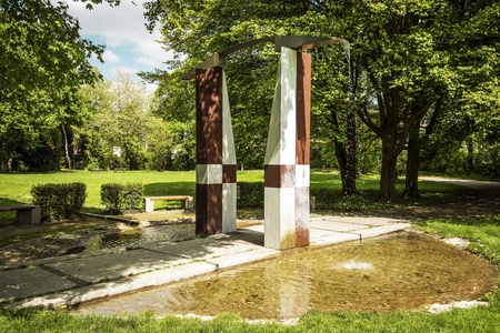 Fountain in a city park of a Bavarian town on a day with sun in spring photo