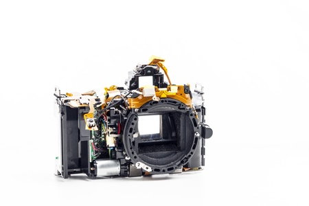 Picture of a disassembled photo camera on white background photo