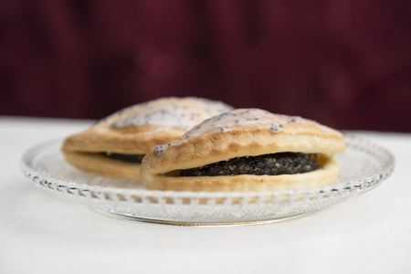 bakery products: Poppy pastry bag on a glass plate
