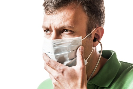 Desperate doctor in green shirt with surgical mask photo
