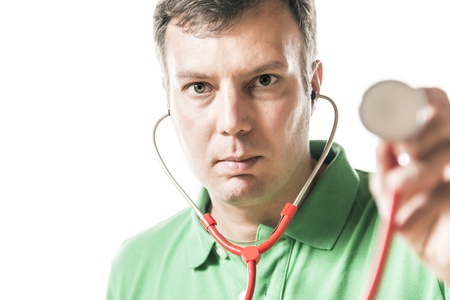 portrait of a doctor in green shirt holding a red stethoscope photo