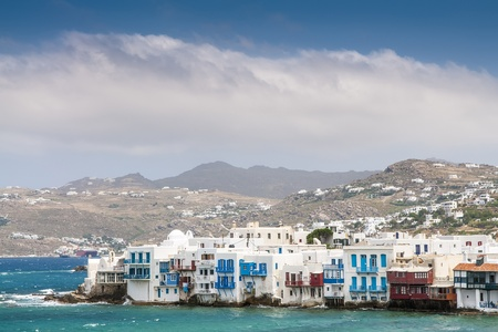 White houses of island Mykonos from the mountains to the sea in sunny weather photo