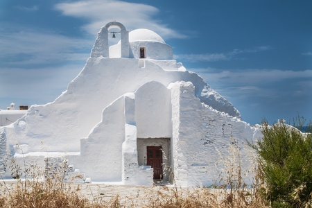Church Panagia Paraportiani on the greek island Mykonos in the agean sea photo