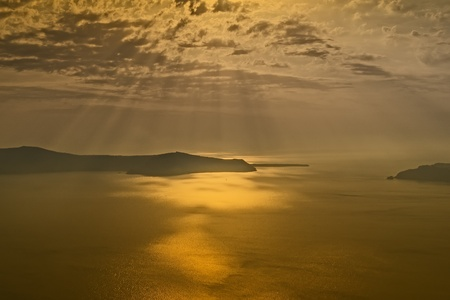 Sunset on the island of Santorini in the Aegean Sea photo