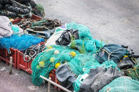 stored: Fishing nets stored in a port in France