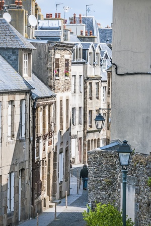 Typical houses in a narrow street in Granville, Haute Normandy, France Stock Photo