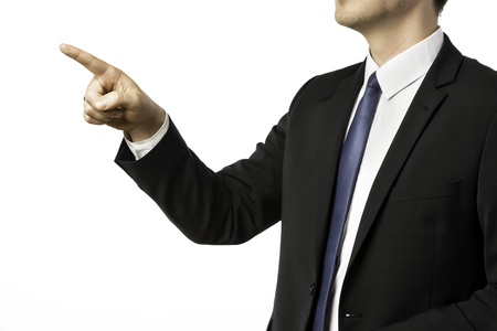 Businessman in dark suit pointing with his finger, isolated on white background