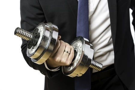 Businessman in black suit with a silver dumbbell