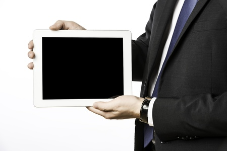 Business man in dark suit with blank tablet computer, isolated on white background Stock Photo - 21145533