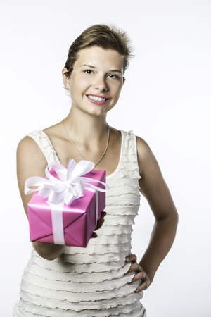 Young brunette girl with birthday, christmas or valentine gift, isolated on white brackground photo