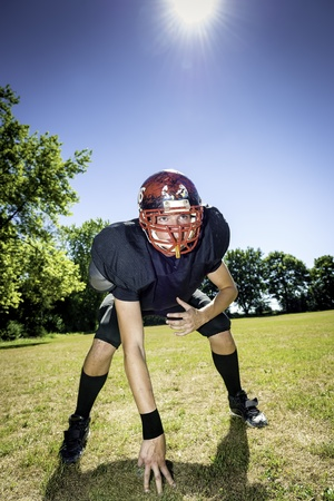 American football player offensive Lineman in three point stance