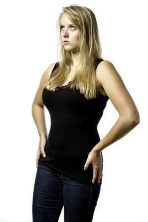 Amazed blonde girl with blue eyes looks upwards isolated on white background photo