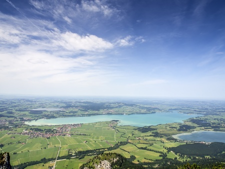 wide: Landscape with lake Forggensee Bavaria and villages, lakes, meadows and forests
