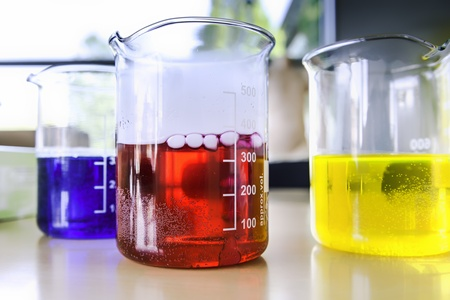 Picture of three chemistry lab measuring glasses