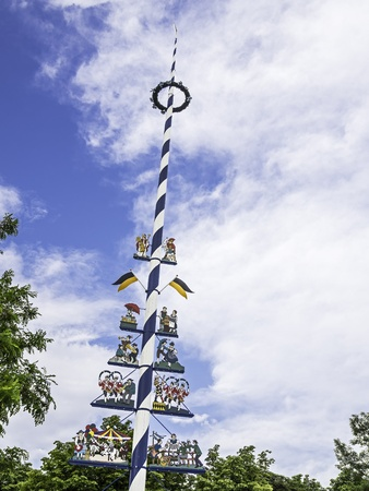 maypole: Picture of a typical traditional bavarian maypole with blue sky and white clouds