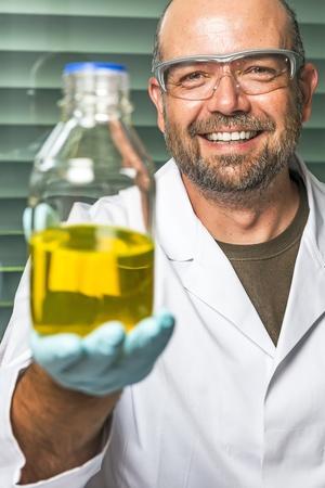 Scientific laboratory technician presents its chemical liquid results photo