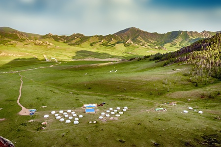 Yourt Camp in Terelj National Park Mongolia with green meadows and animals photo