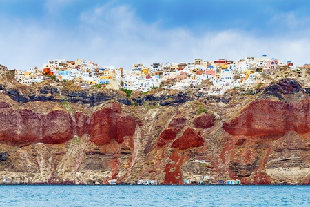 Look at the rocks with Oia on Santorini from the sea Stock Photo