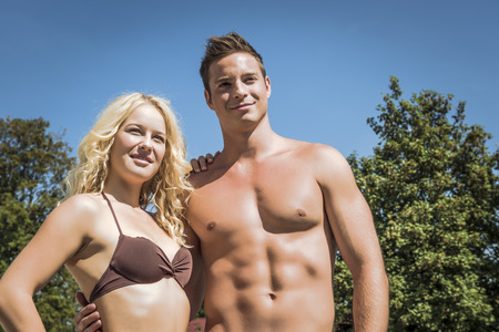 Picture of a young pretty blond girl and a handsome boy wearing swimwear Stock Photo