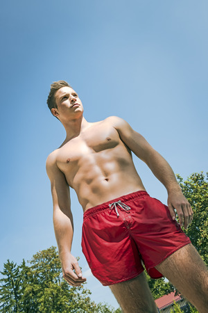 Picture of a attractive young man in swimming shorts