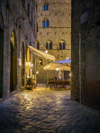 volterra: Night scene in Volterra with narrow alley and restaurant