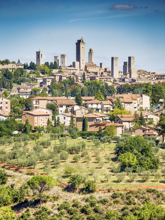 View to the town San Gimignano with blue sky in Tuscany, Italy Stock Photo - 23073923