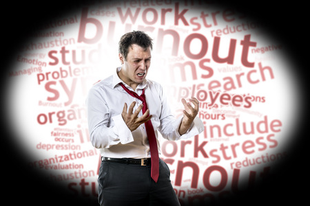 Screaming, desperate man with burnout syndrome Stock Photo