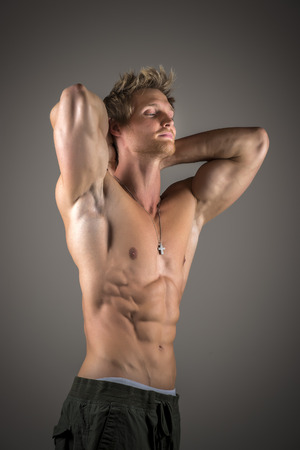 Blond athletic man with well developed abs and pecs photo