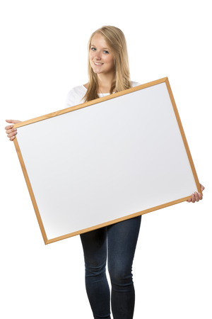 Blond woman is holding blank board, isolated on white background photo